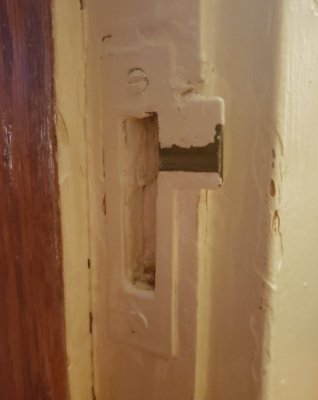 Narrow door strike from a 1921 house
